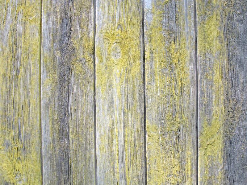 Podława farba na starych drewnianych deskach, szarość i kolorze żółtym, drewniany tło, drewniana tekstura obrazy stock