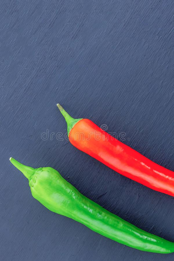 Pod green red pepper couple vegetables bright mature base of hot salsa sauce mexican cuisine royalty free stock images