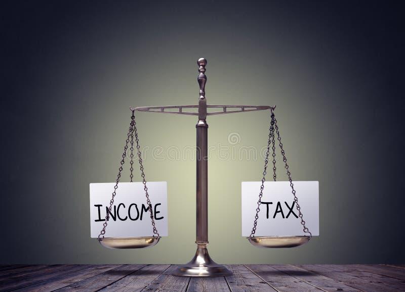Podatku dochodowego równoważenia finanse książki ważą pojęcie zdjęcie royalty free