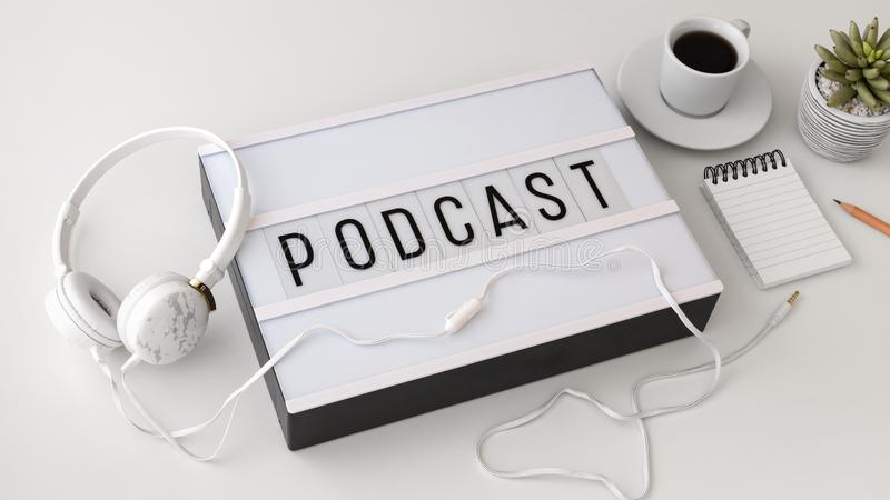Podcast concept with headphones on white background. Podcast concept with headphones on white table stock image