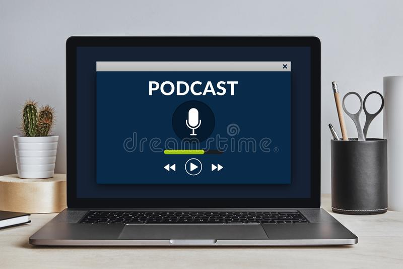 Podcast concept on laptop screen on modern desk. All screen content is designed by me. Front view royalty free stock image