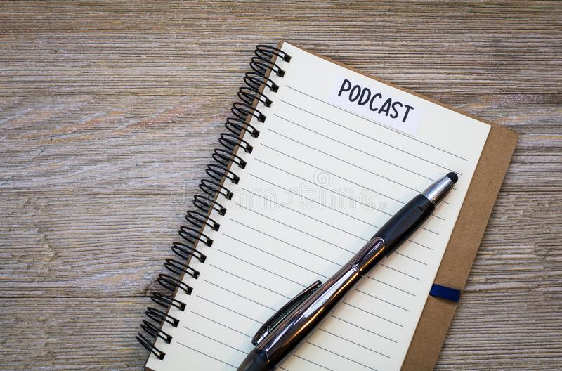Podcast idea concept with notebook on wooden board, flat lay. Podcast idea concept with microphone, notepad and tablet on table. Ideas, plans, topics for Podcast stock photos