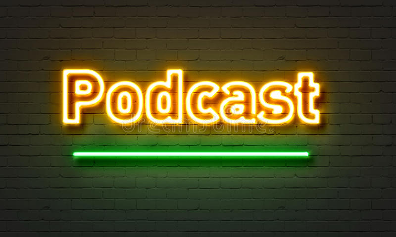 Podcast neon sign on brick wall background. stock photography