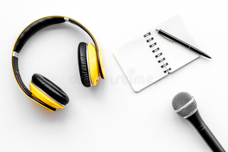 Podcast record with notebook, microphone and headphones on white background top view space for text stock photo