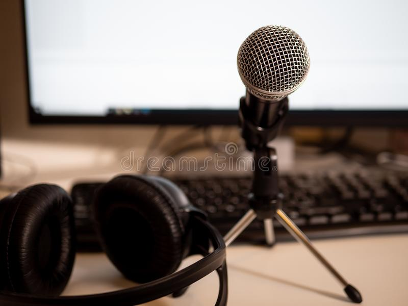 Podcast studio: microphone and computere stock image