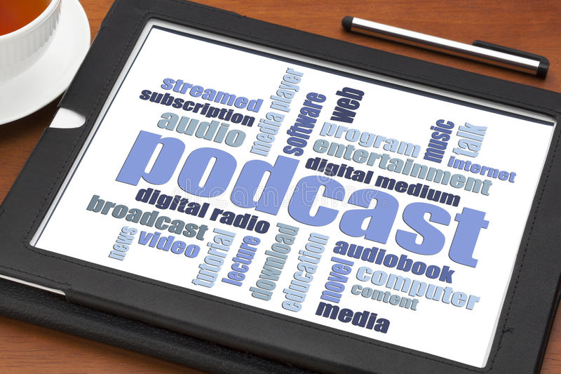 Podcast word cloud on tablet. Podcast word cloud on a digital tablet with a cup of coffee - internet radio concept stock photography