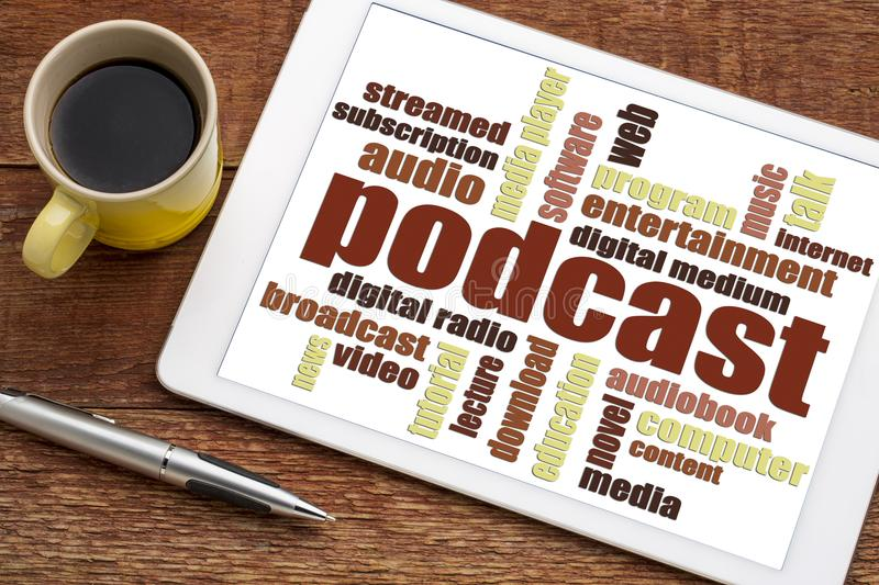Podcast word cloud on tablet. Podcast word cloud on a digital tablet with a cup of coffee - internet radio concept stock photo