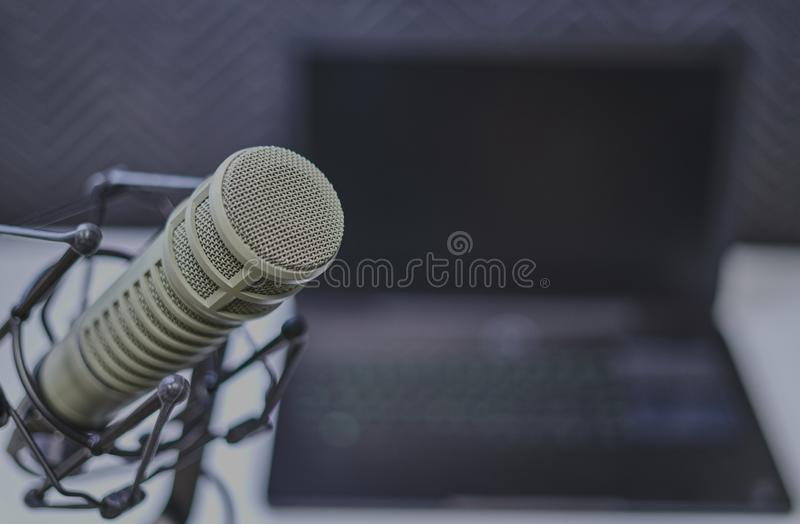 Podcasting setup with microphone in focus stock photography