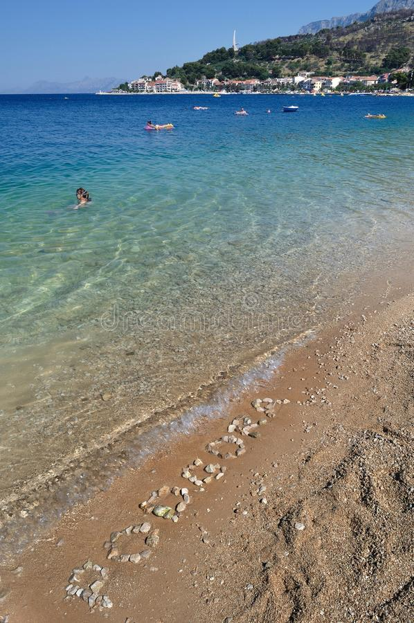 The Podgora word spelled out with pebbles on beach stock images