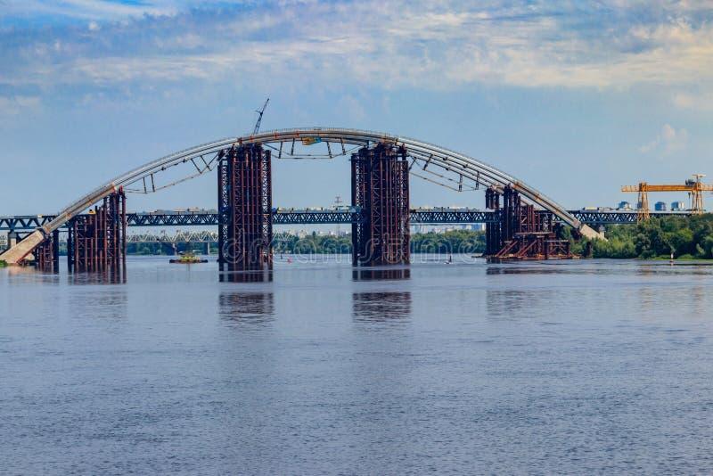Podilsko-Voskresenskyi Bridge or Podilskyi Metro Bridge is a combined road-rail bridge over the Dnieper River under construction stock photo