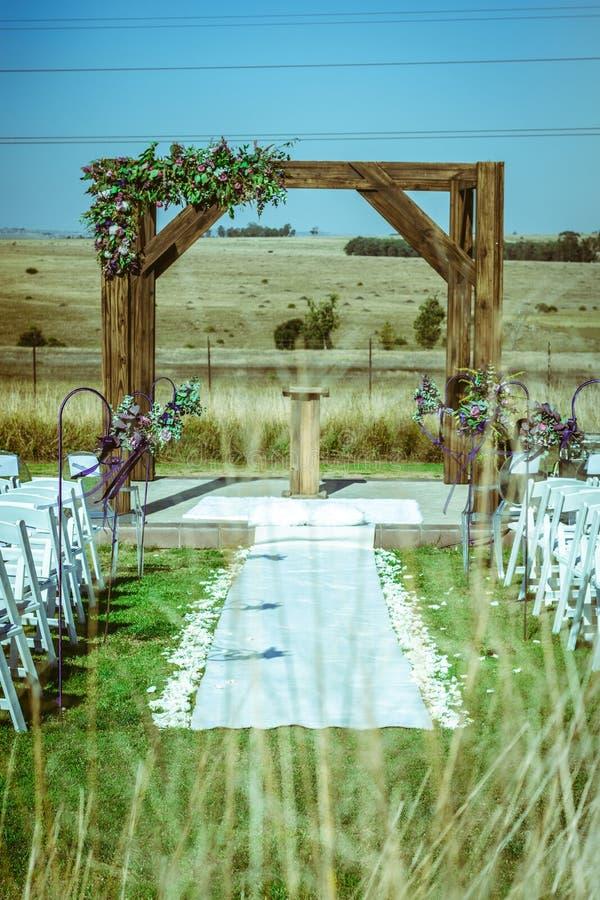 Outdoor Autumn wedding on brown grass stock photos