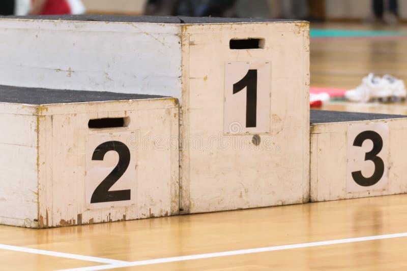 Podium for winner, success in sport activity stock image