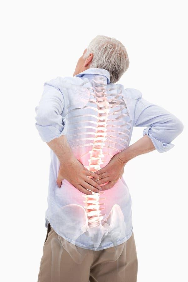 Podkreślający kręgosłup mężczyzna z bólem pleców fotografia royalty free