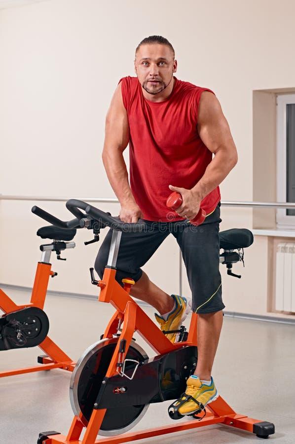 Podobny bycicle kolarstwo w gym zdjęcia royalty free