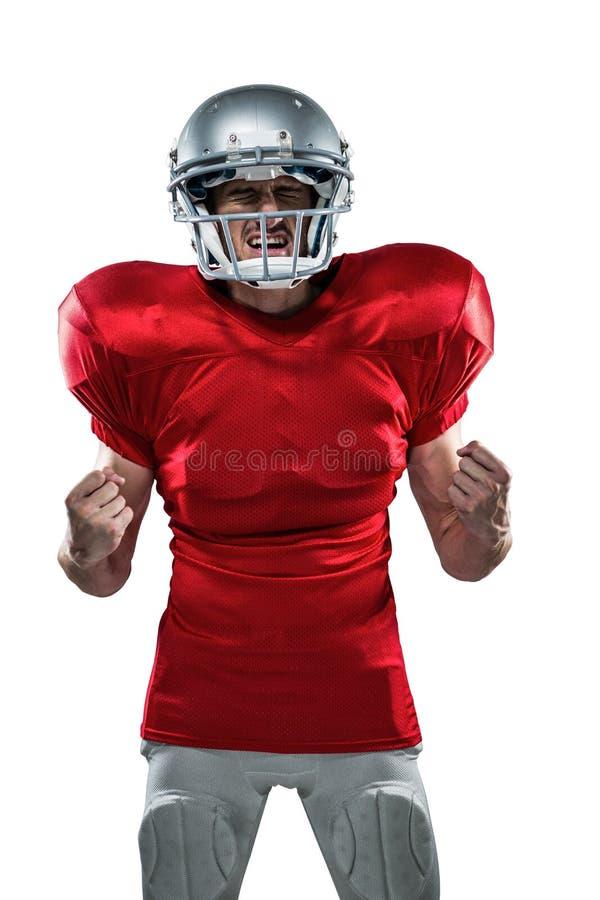 Podrażniony futbolu amerykańskiego gracz w czerwony dżersejowy krzyczeć obrazy stock