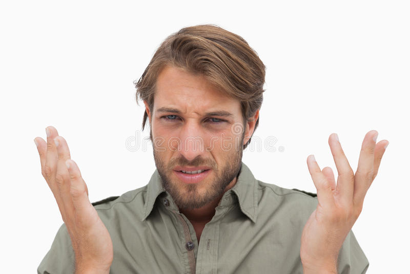 Podrażniony mężczyzna gestuing przy kamerą zdjęcia royalty free