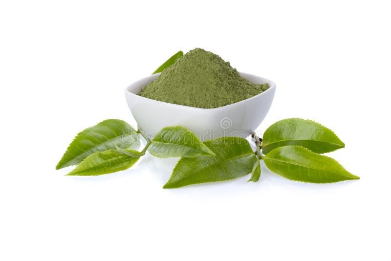 Poeder groene thee en groen theeblad stock foto