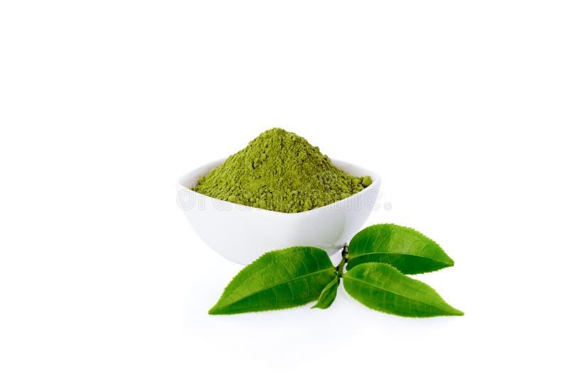 Poeder groene thee en groen theeblad stock foto's