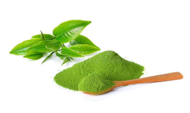 Poeder groene thee en groen theeblad