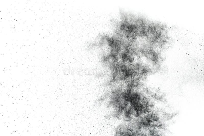A poeira preta abstrata salpica o fundo branco imagem de stock