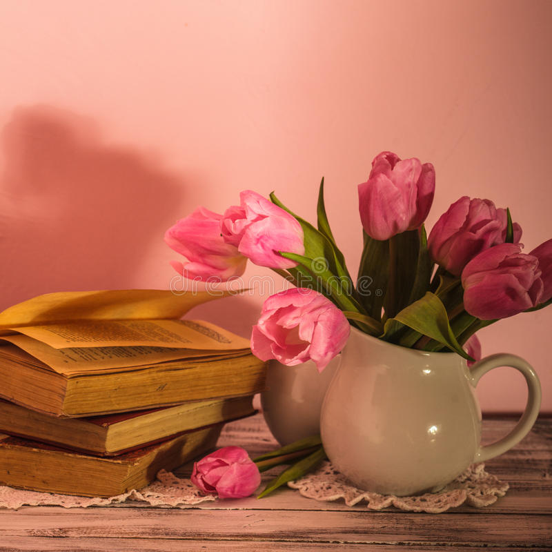 Poem still life. With books and pink tulips royalty free stock photography