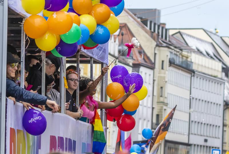 Poeple on a float attending the Gay Pride parade also known as Christopher Street Day CSD in Munich, Germany. 2019: Poeple on a float attending the Gay Pride stock image