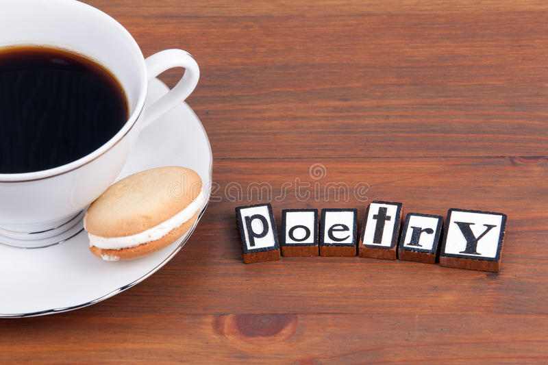 Poetry. On wooden table coffee mug, cookie.  royalty free stock image