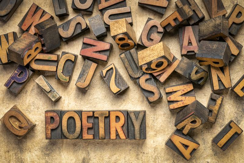 Poetry word abstract in wood type stock photo