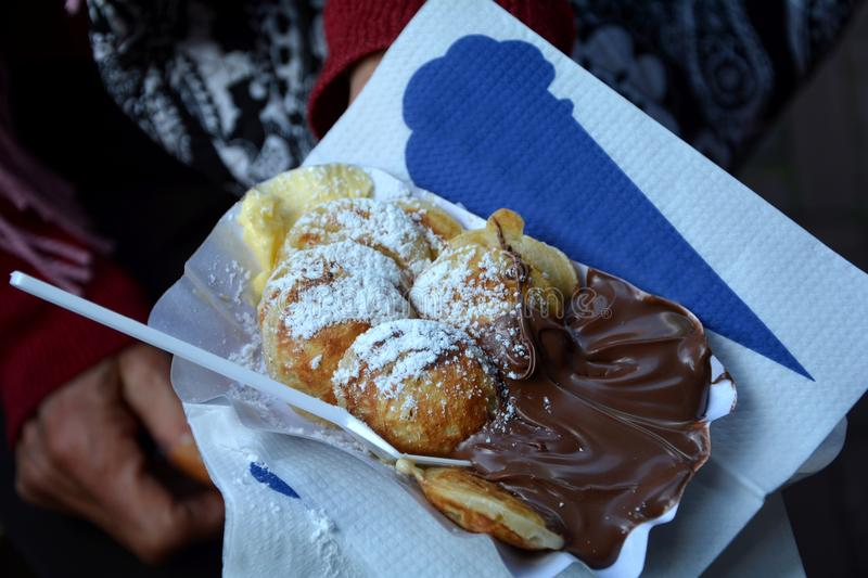 Poffertjes - pancake speciality from the Netherlands with chocolate cream stock photo