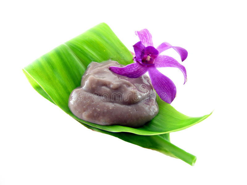 Poi on a tea leaf with an orchid royalty free stock image