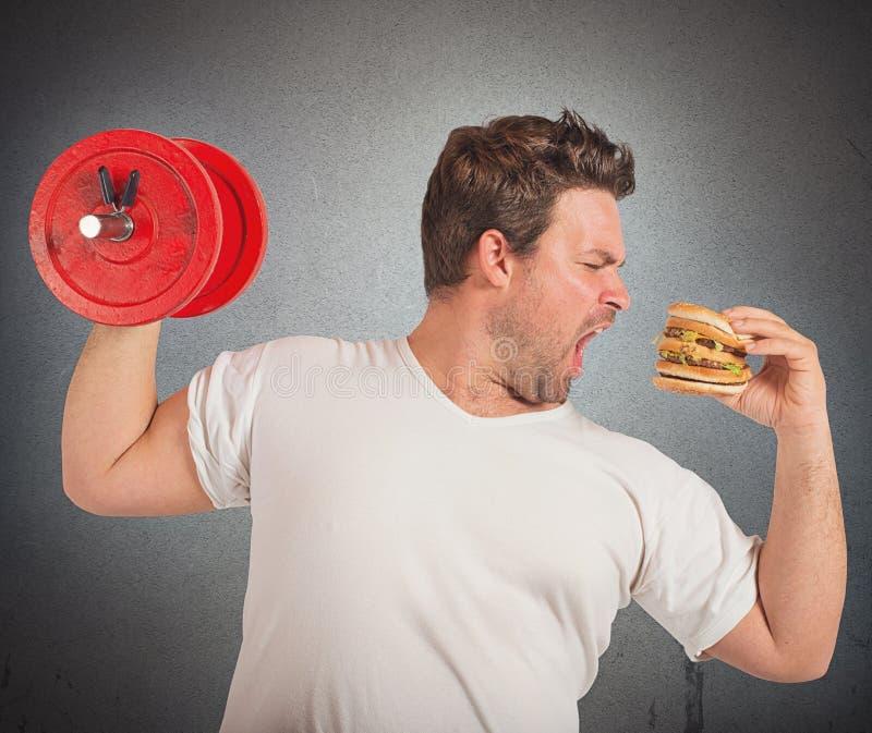 Poids contre le sandwich photos stock