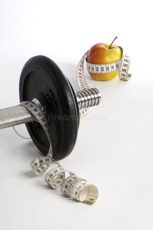 Poids, mètre, pomme image stock