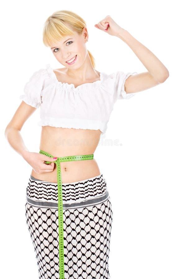 Poids perdu de femme heureuse photo libre de droits