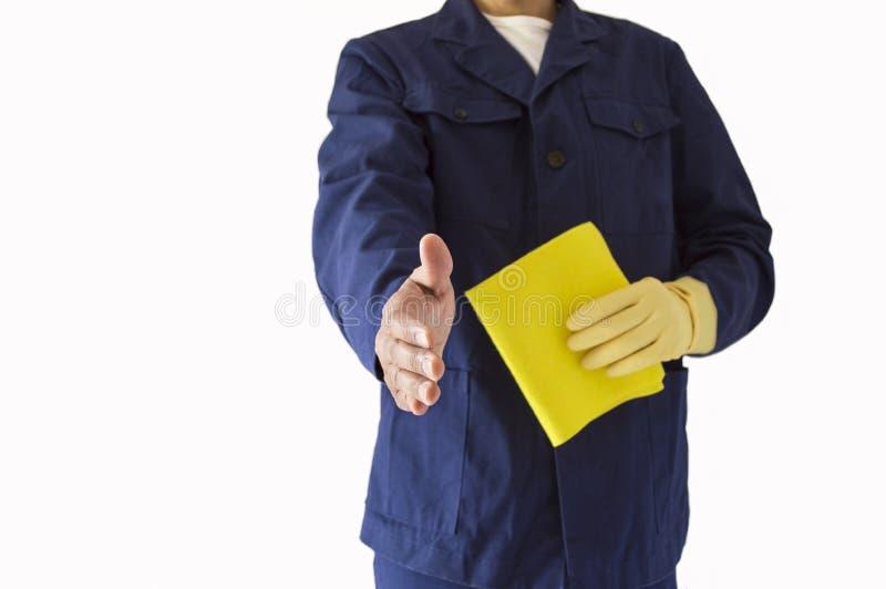 Poignée de main avec un employé de société de nettoyage images libres de droits