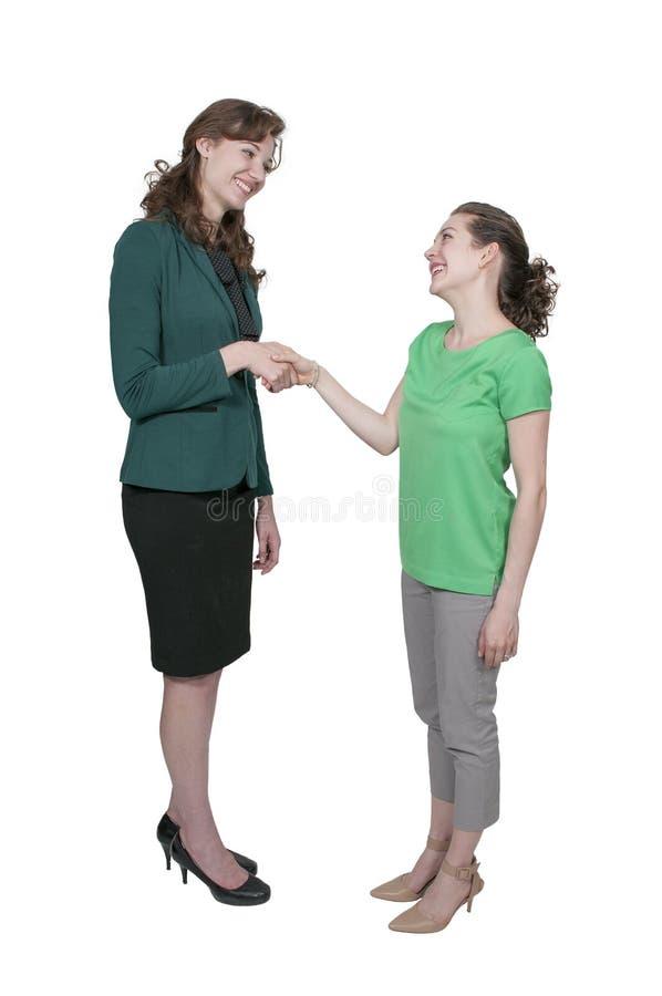 Poignée de main de femmes d'affaires photos stock