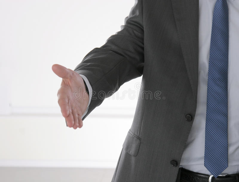 Poignée de main de l'homme d'affaires deux d'isolement sur le blanc photographie stock libre de droits