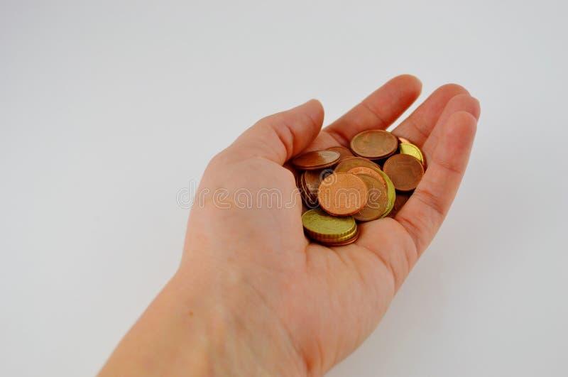 Poignée de pièces de monnaie photographie stock
