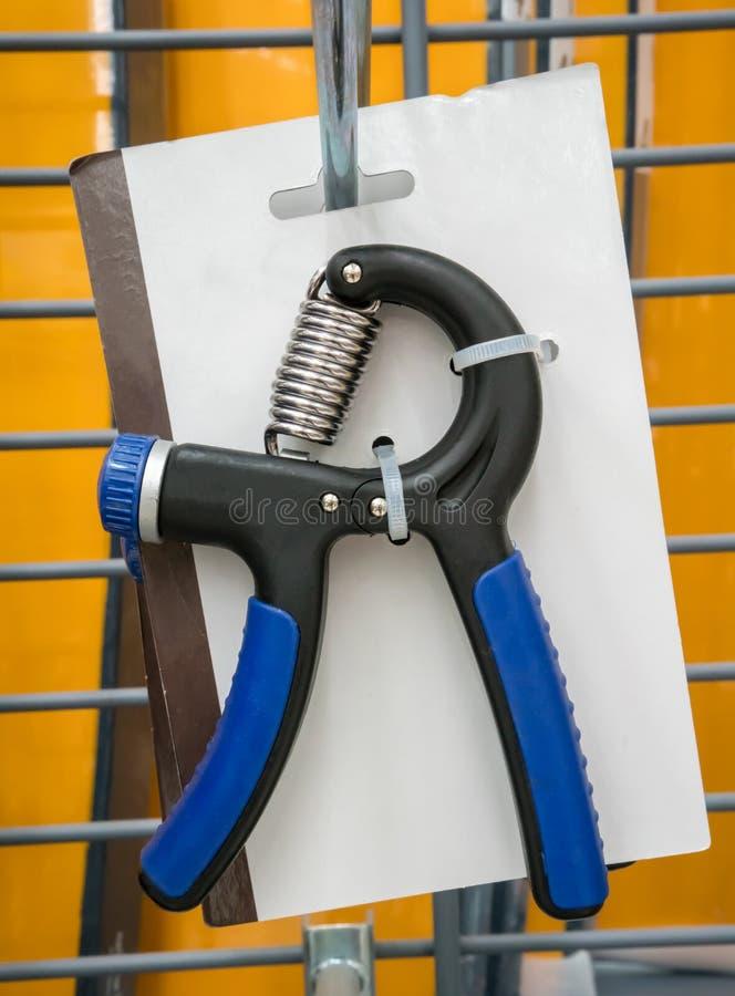 Poignée réglable de main de bleu avec l'anti poignée de glissement pour le bras et les wris image libre de droits