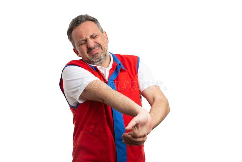 Poignet foulé par fixation des employés d'hypermarché image stock