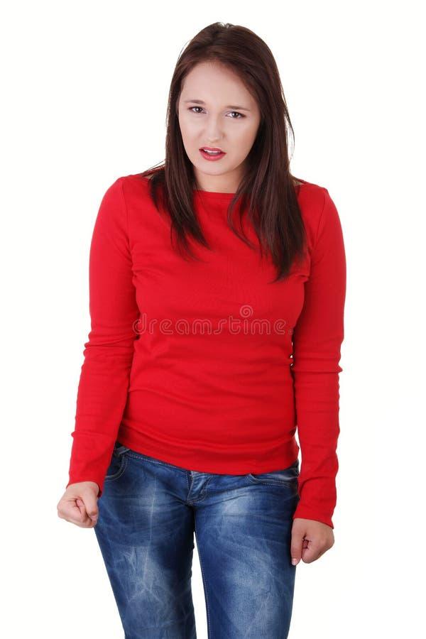 Poings de serrage fâchés de jeune femme. image stock