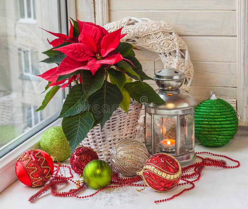 Poinsettia and a lantern in the window on the eve of Advent stock photography