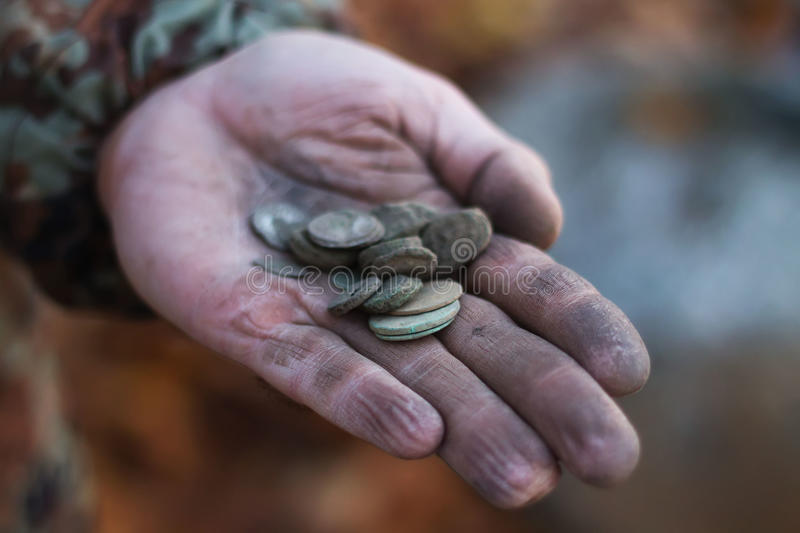 Point of ancient coins in the palm royalty free stock image