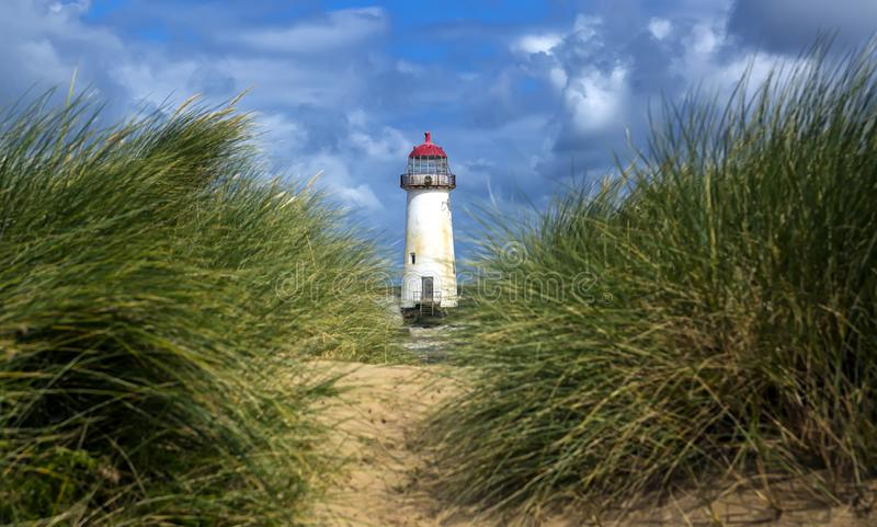 The Point of Ayr Lighthouse, also known as the Talacre Lighthouse, is a grade II listed building situated on the north coast of. Wales royalty free stock photo