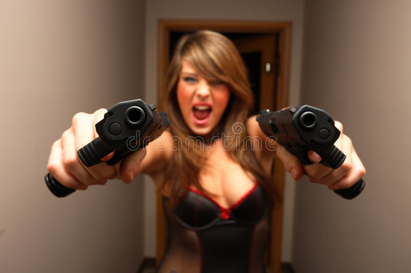 Download Point blank dual pistols stock photo. Image of lifestyle - 3789442