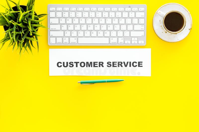 Point of company growth. Customer service concept. Printed words customer service on work desk on yellow background top. Customer service concept. Printed words royalty free stock image