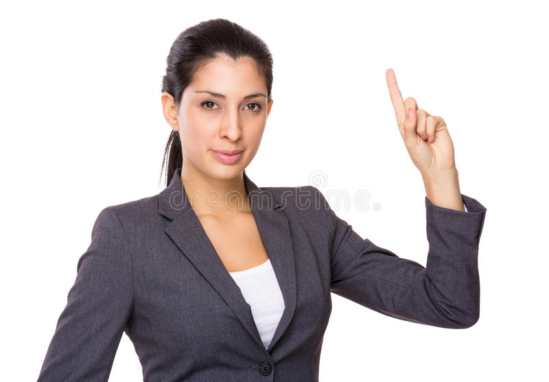 Point de doigt de femme d'affaires vers le haut photo stock