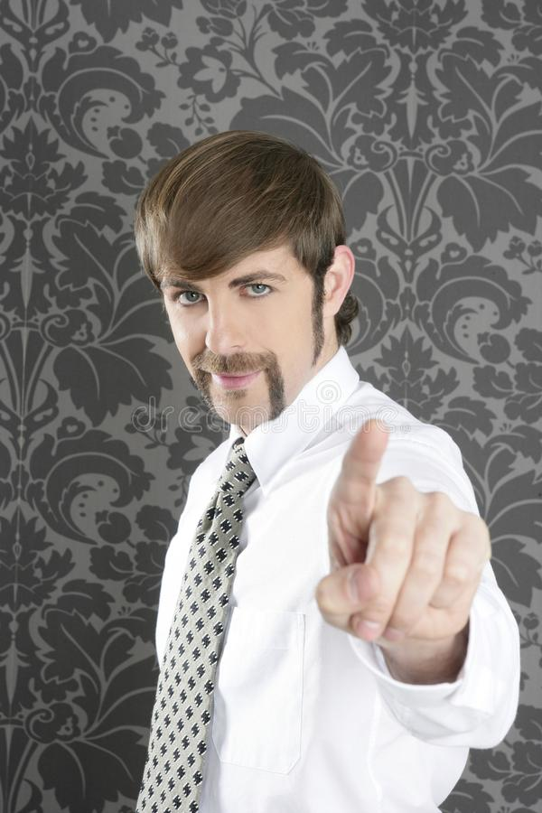 Point finger retro businessman salesperson. On gray vintage wallpaper royalty free stock image