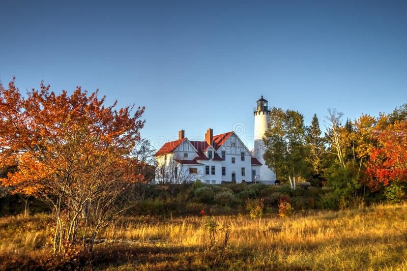 Michigan Autumn Lighthouse Landscape. The Point Iroquois Lighthouse framed by fall foliage on the coast of Lake Superior. Hiawatha National Forest. Brimley stock photos