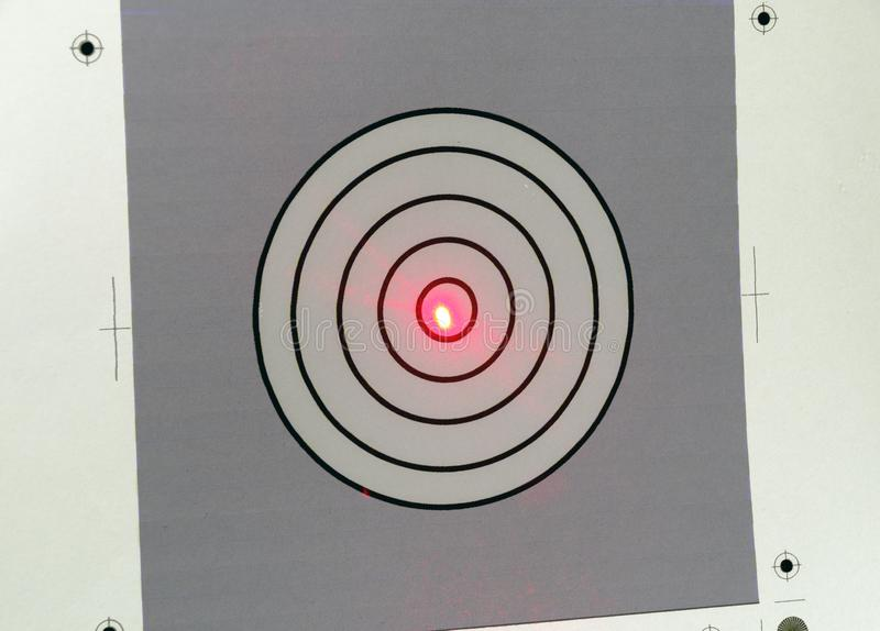 Red point of a laser beam stock image