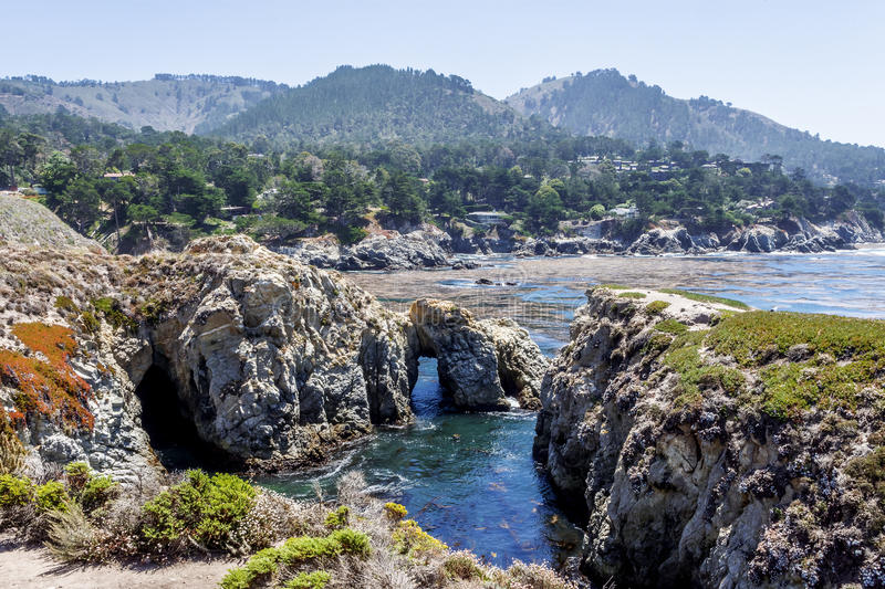 Point Lobos State Natural Reserve, with rock, water caves. And geological formations along the rugged Big Sur coastline, near Carmel and Monterey, CA. on the stock image